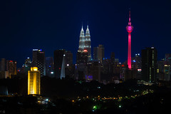 Evening in Kuala Lumpur (4tun8bug) Tags: kualalumpur malaysia city cityscape towers buildings lights parliamenthouse petronastowers communicationtower night outdoor color canont5i commercial colorful evening travel architecture skyline twintowers
