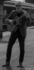 Guitarist (handmiles) Tags: street station train lens photography guitar sony april tamron guitarist westbury a58 2015 18mm200mm sonya58 miles2015