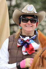 All American Cowgirl (wyojones) Tags: horse woman cute girl beautiful smile hat sunglasses hair pretty texas houston shades parade gloves blonde earrings vest cowgirl lovely bandana 2012 houstonlivestockshowandrodeo hatpins cowgirlhat saltgrasstrailride wyojones scatf houstonlivestockshowandrodeoparade