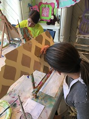 Jessica and Emily are focused on painting.