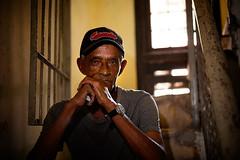Sharlie (waterfallout) Tags: portrait portraits havana cuba moody lighting moodylight moodylighting man person cuban hat baseballhat baseballcap stairwell