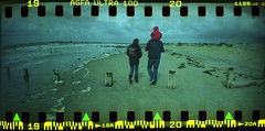 a winter stroll at the beach (fitzhughfella) Tags: 35mm walking seaside sand agfa agfaultra westwittering sprockets sprocketrocket sprocketography