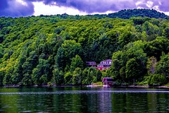 Massawippi Lake (Sky Solar) Tags: trees light house lake mountains reflection green nature water clouds composition landscape coast scenery bright background scenic massawippi