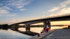 Fisherman doing his thing (Peter Nystroem) Tags: kalix river sunset fishing fisherman bridge landscape norrbotten sweden peternystrmphotography