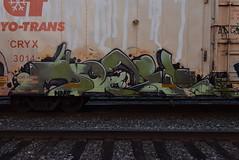 NOVEL (TheGraffitiHunters) Tags: graffiti graff spray paint street art colorful freight train tracks benching benched novel reefer boxcar