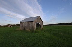 Field with barns (Mika Lehtinen) Tags: skogsvgar barn oldbarn hay field grass green lada finland summer sky sigma wideangle evening blue landscape greenfields