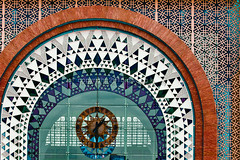 Marrakech Express (Dave G Kelly) Tags: africa travel detail brick clock glass station architecture facade design holidays arch transport morocco trainstation marrakech buildingexterior builtstructure