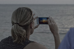 Capture the Moment (brucetopher) Tags: ocean pink sunset red sea summer sky orange woman cloud nature water beautiful beauty weather night clouds sunrise hair evening photo twilight onthebeach waves skies pattern glow photographer purple watch earring violet blond blonde stunning click ponytail ripples braids capture shoulder cloudscape phonephoto braid afterglow iphone summernight takeapicture amazingsky cloudpattern amazingskies capturethemoment