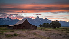 Sunset at Moulton Barn (Jeremy Duguid) Tags: park trees sunset sky usa mountains west nature colors clouds barn landscape evening landscapes colours hole dusk sony barns parks grand jeremy jackson national western wyoming peaks teton tetons cloudscapes wy moulton duguid