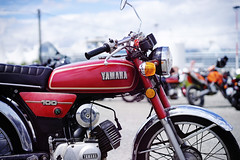 100 CCs of fury! (Eric Flexyourhead (shoulder injury, slow)) Tags: old red canada classic bike vancouver zeiss japanese downtown bc bokeh britishcolumbia retro motorbike motorcycle yamaha 100 shallowdepthoffield 2016 theshop waterfrontroad 55mmf18 yamaha100 sonyalphaa7 zeisssonnartfe55mmf18za spitnshine 2016spitnshinevintageandcustommotorcycleshowandshine