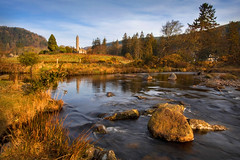 Golden Glendalough (explored) (Alan10eden) Tags: morning ireland light mountains reflection history water graveyard sunrise canon river landscape dawn countryside site spring rocks stream stones wideangle glendalough april fields brook wicklow 1022mm goldenhour monastic roundtower countywicklow laragh 70d alanhopps