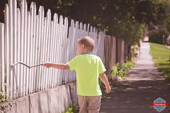 Stick on a Fence (Rob Moses) Tags: street city boy urban canada calgary love fence wonderful fun kid child metro citylife sidewalk alberta stick neighbourhood renfrew timeless yyc bridgeland whitepicket