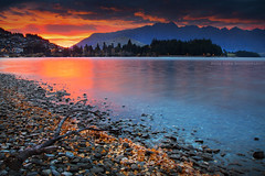 Day Blaze || QUEENSTOWN || LAKE WAKATIPU (rhyspope) Tags: new autumn sunset sky mountain lake pope color colour reflection fall water clouds sunrise canon rocks shoreline zealand nz queenstown 5d wakatipu rhys remarkable mkii rhyspope