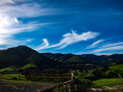 The Volcanic Hills (Steve Taylor (Photography)) Tags: volcanic hills gate landscape fence blue green brown white wood wooden newzealand nz southisland canterbury bankspeninsula shadow spring sunset cloud sky sunny sunshine littleriver