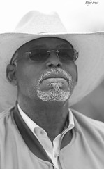 Trail Rider (wyojones) Tags: blackandwhite bw white man black hat sunglasses shirt beard cowboy texas houston shades parade jacket grayscale cowboyhat greyscale houstonlivestockshowandrodeo trailrider wyojones houstonlivestockshowandrodeoparade
