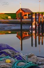 Past and present (MaiGoede) Tags: landscape harbor nikon earlymorning hafen landschaft morningsun ammeer wesermarsch dgzrs fischerhafen wesermndung rettungsschuppen alterrettungsschuppen