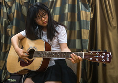 North korean teen defector in yeo-mung alternative school playing guitar, National capital area, Seoul, South korea (Eric Lafforgue) Tags: people musician music woman playing horizontal youth student asia sitting guitar refugee young lifestyle player indoors teen seoul sit teenager acoustic youthful plays southkorea youngadult guitarist sparse oneperson teenage defector 1819years northkorean 1617years 1people nationalcapitalarea colourpicture koreanethnicity sk162366