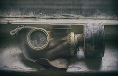 Mask of Sorrow (Martyn.Smith.) Tags: urbex decay abandoned gasmask soviet militaryarmy analogue efex canon50mmprimelens decayed abandonedwunsdorf sovietbase ussr urbanexploration coldwar eastgermany vignette dust rusted corroded dusty wunsdorfmilitarybase