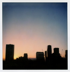 Upstairs Sunset 1 (tobysx70) Tags: the impossible project tip polaroid sx70sonar sonar instant color film for sx70 type cameras impossaroid upstairs sunset ace hotel broadway dtla downtown los angeles la california ca bar cityscape skyline skyscraper highrise silhouette blue sky dtlapolawalj2 polawalk 071616 toby hancock photography
