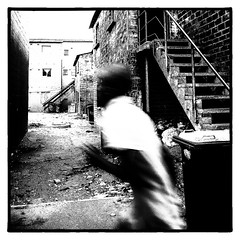 Rushing home (Bilderschachtel Photography) Tags: outdoor outdoors monochrome man minimalism minimal citylife city contrast candid capetown street streetphotography strasenfotografie streetlife schwarzweiss bw blackandwhite blackwhite blured south africa township langa