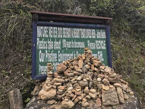 Sign with rock pile, before