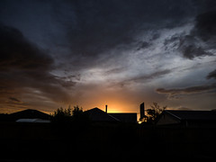 Sundown (Steve Taylor (Photography)) Tags: sunset dusk chimney garage house roof black brown grey lowkey newzealand nz southisland canterbury christchurch northnewbrighton tree shape silhouette vignette summer twilight sun sky cloud sundown