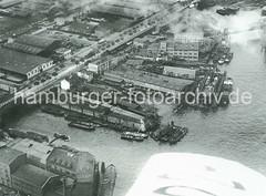 X11232_16_53 Luftaufnahme der Norderwerft am Reiherstieg in Hamburg Steinwerder - ein Schiff liegt im Schwimmdock; im Hintergrund der Ellerholzdamm und Steinwärder Kanal. (christoph_bellin) Tags: fotos hamburger hafen bilder entwicklung geschichte alte werft historische fotoarchiv bootsbau schiffswerft werftarbeiter