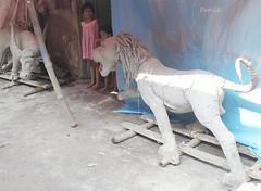 Lion at the door step (pathikdebmallik) Tags: india children buffalo lion kolkata calcutta westbengal streetsofkolkata northcalcutta