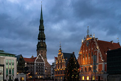 Town Hall Square and the House of Blackheads with St. Peter's Cathedral in Riga (Viktor Descenko) Tags: santa christmas street new old city travel light urban house building tree tower history tourism church st architecture night facade square outdoors town hall europe european exterior place cathedral traditional famous year capital culture center scene baltic structure latvia peter ornate lutheran riga latvian blackheads