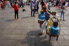 Penjaja Es (Johanes Tarigan) Tags: street old shadow party people man canon indonesia lens photography eos jakarta sp if af es tamron f28 xr kota ld tua crowded selendang khas aspherical mayang jadul betawi 1750mm 40d thrid penjaja