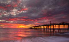 Nags Head Sunrise (dlos') Tags: ocean motion beach water beautiful clouds sunrise pier fishing colorful waves atlantic nagshead obx southeasternunitedstates