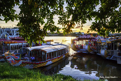 Cruise boats moored along the bank of Perfume River (Pic_Joy) Tags:   south east asia     sng hngcutrngtin trng tin bridgeperfumeriver  cruiseboat  hue hu