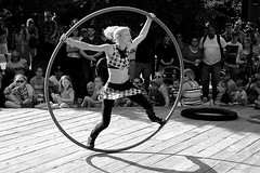 Summer 4 (halifaxlight (mostly off until August)) Tags: canada novascotia halifax internationalbuskerfestival busker woman hoop acrobatics crowd shadows bw