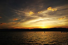 Little golden clouds (nathaliedunaigre) Tags: sunset sky mountain lake water clouds landscape gold golden twilight emotion or lac ciel hommage nuages paysage lman inmemoriam coucherdesoleil laclman motion