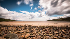 Sun trap (MBDGE) Tags: longexposure blue seascape beach stone bay scotland sand orkney rocks alba shoreline le shore skycloud neutraldensity waulkmill canon70d