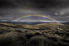 Kepler Rainbow (robertdownie) Tags: rainbow clouds new zealand dark track stormy hills south island dusk meadow trekking grassland hut nz alpine gloomy kepler great walk luxmore