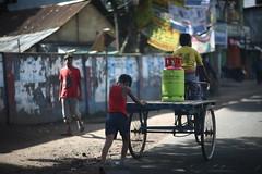 All for a cylinder of gas (N A Y E E M) Tags: child labourer gas cylinder rickshawvan morning street patiya chittagong bangladesh colors windshield sooc raw unedited untouched light