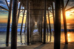 Time and Tide (KC Mike D.) Tags: pier sea pacific ocean wood structure woman seashell surfer oceanside water waves light sunset sun shadow vanishing point