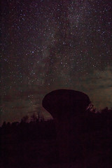 Clouds coming in over rock under night sky (PhotoStorm22) Tags: wy wyoming vedauwoo stars night sky rock rocks rockformation rockformations milkyway