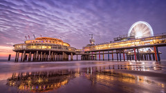 Fun at the beach (miguel_lorente) Tags: night netherlands sunset purple city cityscape structure depier lights longexposure ferriswheel nightlights building holland seascape scheveningen clouds nightshot wheel