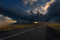 Even the weather can't decide (Ron Jansen - EyeSeeLight Photography) Tags: iceland south east stokksnes weather sun sunset sky cloud clouds drama dramatic rain sunray ray rays sunrays cloudy dark mood wide angle road ringroad depth perspective d810 nikonafsnikkor1424mmf28ged