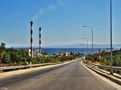 electricity power factory...Mytilene Lesbos Greece (panoskaralis) Tags: power electricity factory energy mytilene lesbos lesvosisland greece greek hellas hellenic island sea seaside bluesea bluesky sky road aegeansea