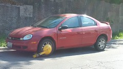 Booted Neon (artistmac) Tags: chicago il city urban street denverboot boot booted car automobile american dodge neon 4door sedan red compact small mopar innameonly tickets dontpileupticketsandthenparkoutdoorsidiots