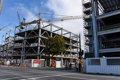 Getting Taller (Jocey K) Tags: street trees newzealand christchurch sky people architecture clouds buildings construction cranes southisland cbd buildingsite rebuilds durhamstnorth