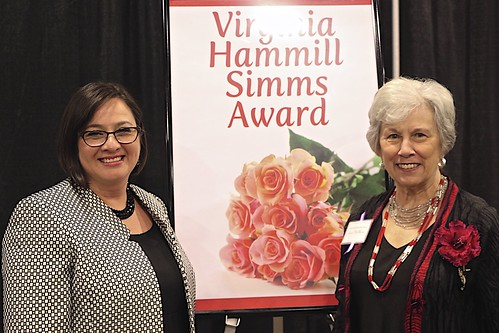 HMC Board President, Linda McAllister (on right) receives Simms Award
