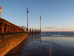 Distant (adrianwoolgar) Tags: sea sky cloud beach water sand pipe shore adur southwickbeach