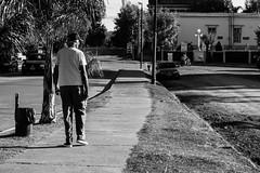 Un extrao andar (martinnarrua) Tags: street bw man byn blancoynegro argentina walking person persona nikon walk amateur hombre caminando streetfotography nikond3100