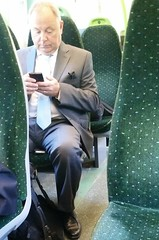 Stranger On A Train (Monsieur Tout Le Monde) Tags: sexy smile mobile businessman train bag daddy happy phone cellphone handsome tie grandpa suit grandad southend shoeburyness dominic domi c2c bulge silverfox loafers welldressed beautifulstranger dressshoes chalkwell thorpebay westcliffonsea sneakyphoto killworth dominickillworth suiteddaddy