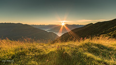 Sunrise from Galbiga in 16:9 (Diego Pianarosa (aka Pinku)) Tags: orange mountain lake como green colors sunrise landscape lago alba wideangle sole paesaggio pinku starbust diegopianarosa