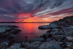 Colour explosion (huddart_martin) Tags: blue sunset red sea sky seascape norway clouds landscape fire coast norge rocks shoreline shore coastline sotra ygarden sonya99